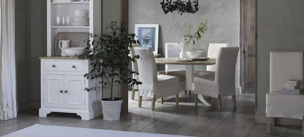 Long Island dining chairs with natural loose covers by Neptune