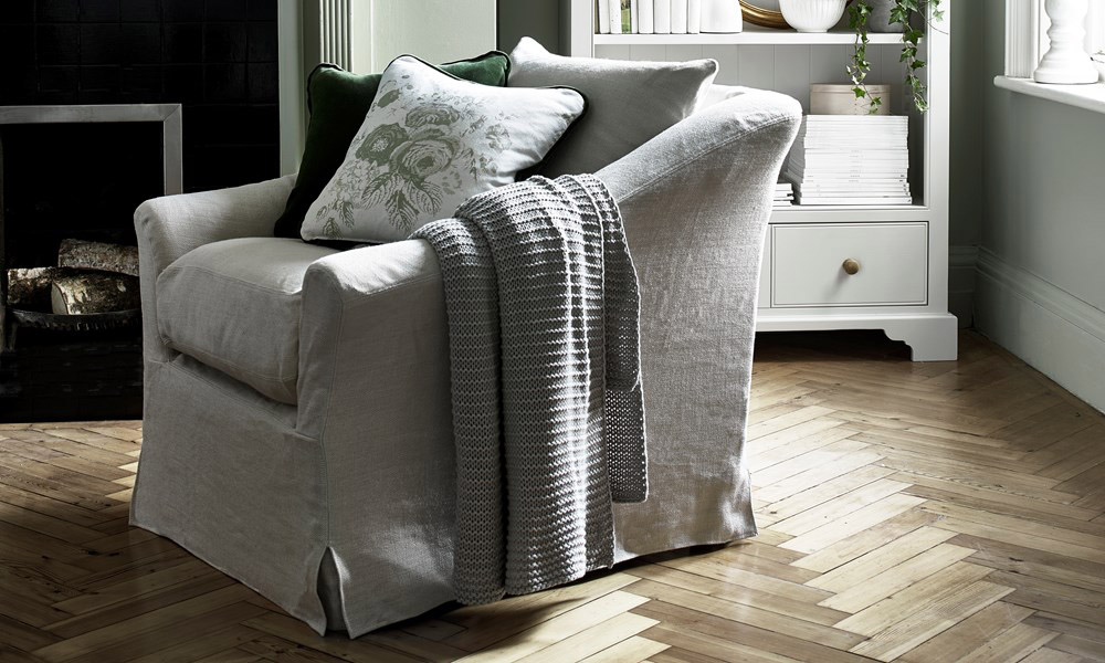 Long Island armchair with linen loose cover by Neptune