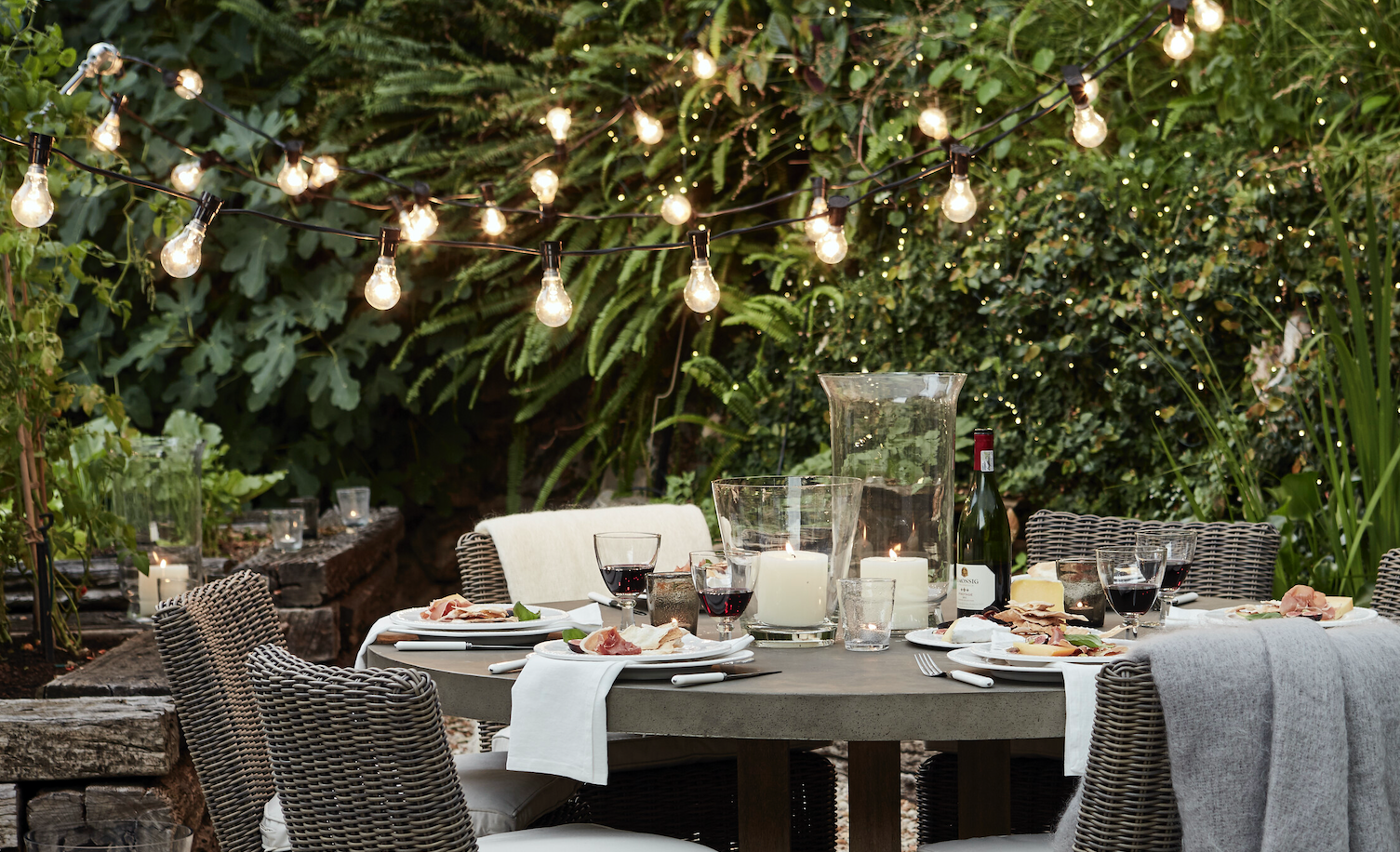 Neptune Hudson table and Rosewood festoon lights